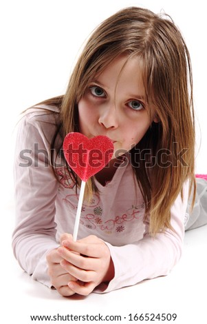 girl and lolipop isolated on the white background - stock photo