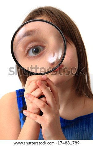 girl and magnify glass isolated on the white background - stock photo