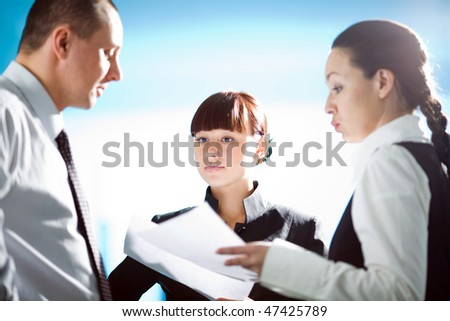Girl and men with women on blue background - stock photo