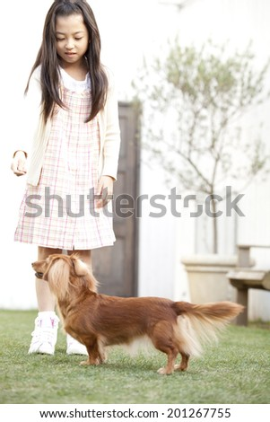 Girl and miniature dachshund