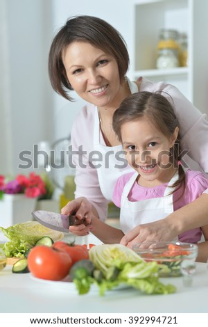 girl and mother prepare food