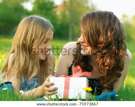 Girl and mother with white present box - stock photo