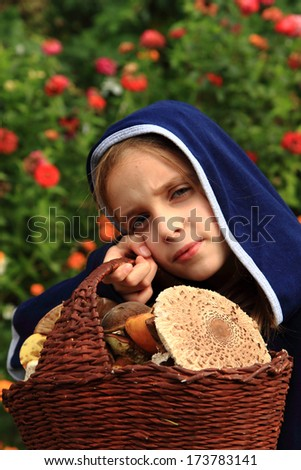 girl and mushrooming ( parasol mushrooms and other) - stock photo