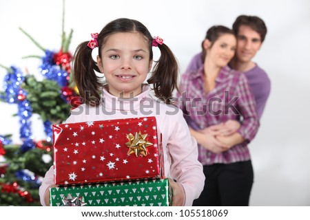 Girl and parents with Christmas presents - stock photo