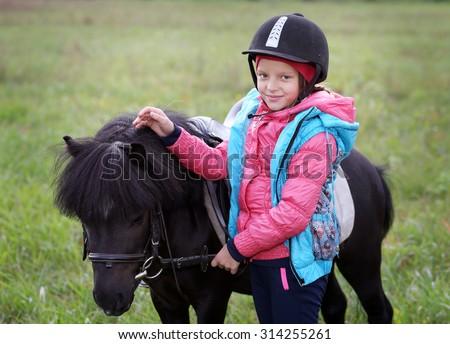 girl and pony - stock photo