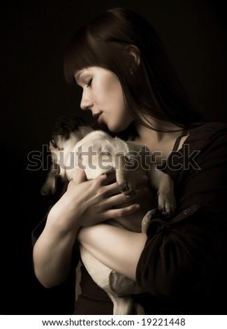 Girl and pug, studio shot - stock photo