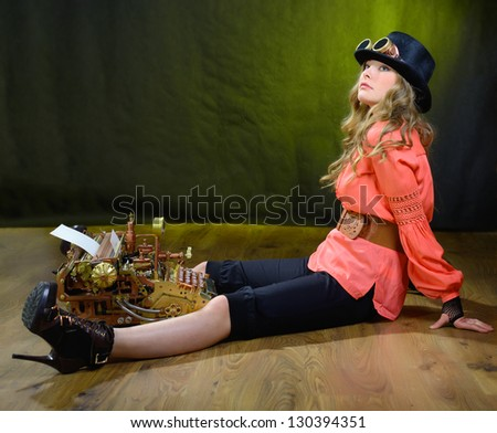 Girl and Steampunk style future Typewriter. - stock photo