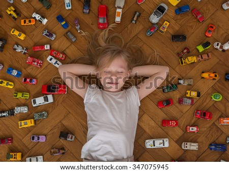 girl and toy car   - stock photo