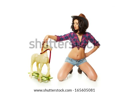 Girl and toy horse - stock photo