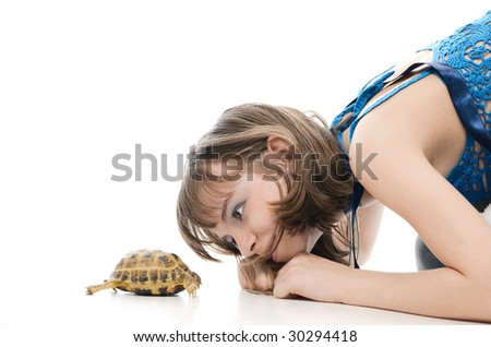 Girl and turtle - stock photo