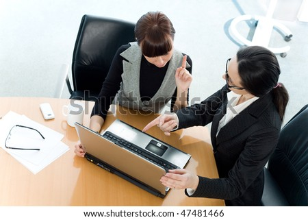 Girl and women at table - stock photo