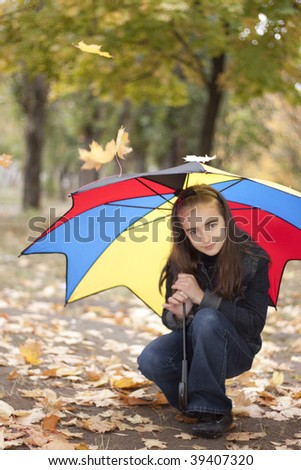 Girl and yellow leaves at autumn - stock photo
