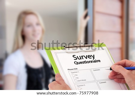 Girl Answering Market Research Survey Questionnaire Questions at the Door - stock photo