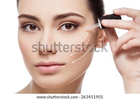 Girl applying anti wrinkle serum - stock photo