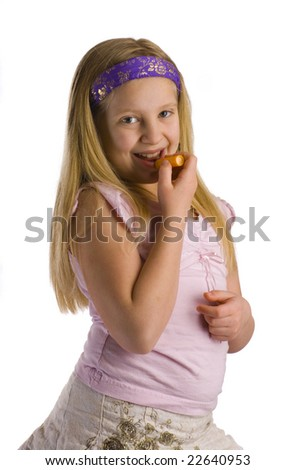 Girl applying lip balm salve to her chapped lips - stock photo