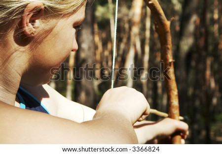 Girl-archer in the forest - stock photo