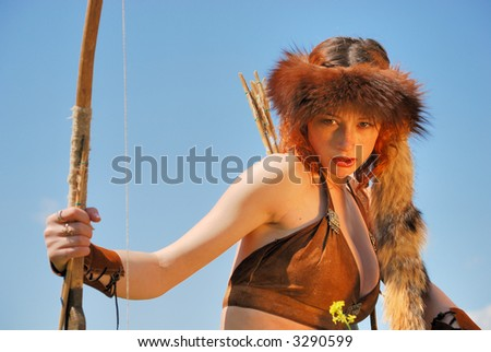 Girl-archer on the sky-background - stock photo