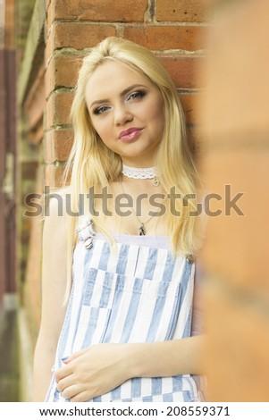 girl at a brick wall - stock photo