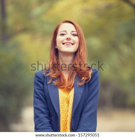 Girl at autumn outdoor - stock photo