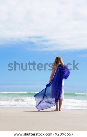 Girl at beach with purple sarong