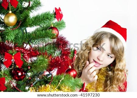 Girl at Christmas tree - stock photo