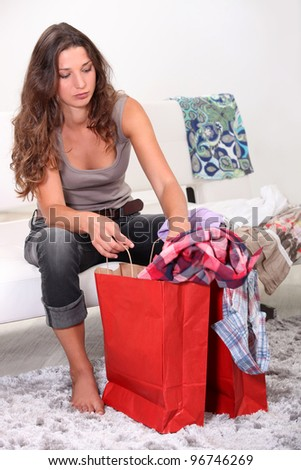 girl at home after shopping frenzy - stock photo