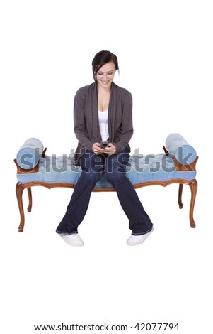 Girl at Home texting sitting on the couch - stock photo