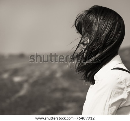 Girl at outdoor. Photo in black and white style.