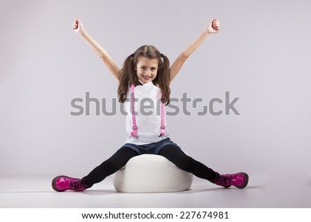 Girl at studio with her arms outstretched - stock photo