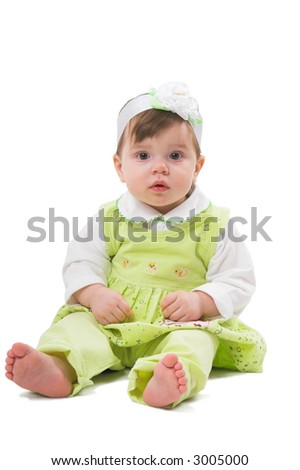 Girl at the age of 1 year sitting on white background