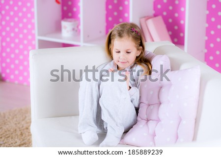 Girl at the room  looking at tablet PC  - stock photo