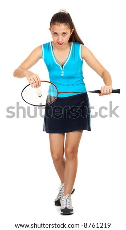 girl athlete playing badminton - ready to give a smash serve - stock photo