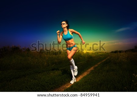 girl athlete runs on road - stock photo