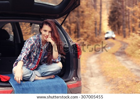 Girl autumn trip by car - stock photo