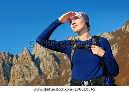 girl backpacker looking into the distance - stock photo