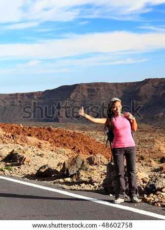 Girl Backpacking / Hitchhiking on Teide, Tenerife. Mixed chinese / caucasian woman model.