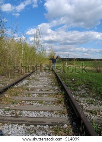 Girl  balancing on rail - stock photo