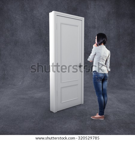 Girl before a white door in fear of the unknown