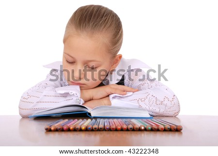 girl behind a table reads the book on white bacground