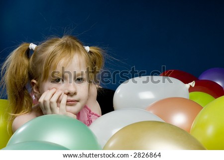 Girl between balloons - stock photo