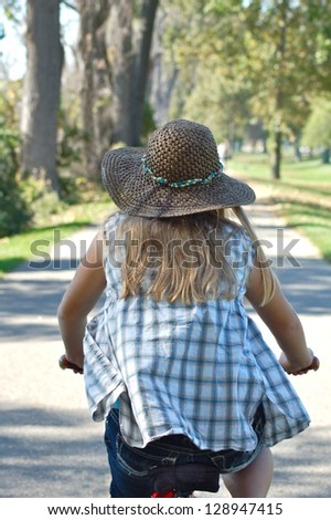 Girl Bike Riding From Behind - stock photo