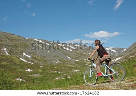 Girl biking in high mountains. #4 - stock photo