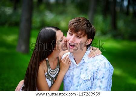 Girl bite on boyfriend shack - stock photo
