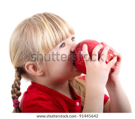 Girl biting a red apple - stock photo