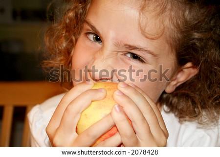 Girl biting an apple - stock photo