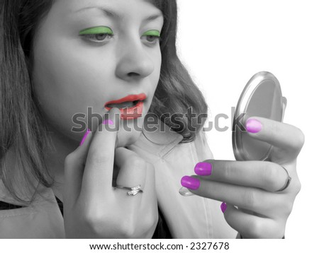 Girl (black-white) and cosmetics (coloured), isolated - stock photo