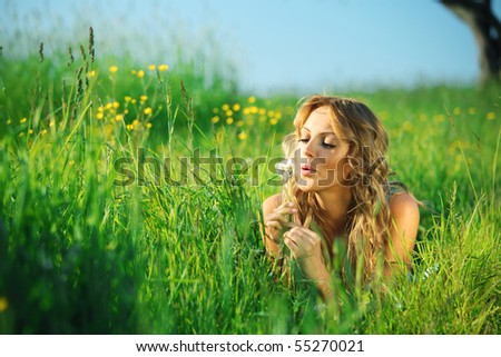 girl blow on dandelion - stock photo