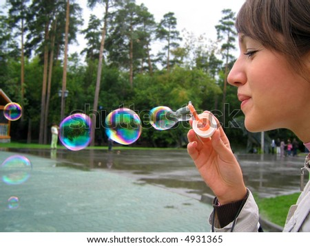 girl blow soapy bubble