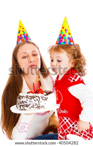 Girl blowing at her birthday cake