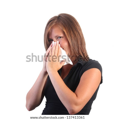 girl blowing nose - stock photo